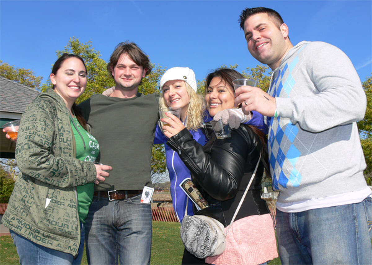 From left, Stephanie Duke of Ansonia, Dave Abel of Shelton, Pamela John of Shelton, Jenny Jarrin of Naugatuck and Paul John of Shelton (Pamela's husband) are all smiles during the Hoptoberfest.