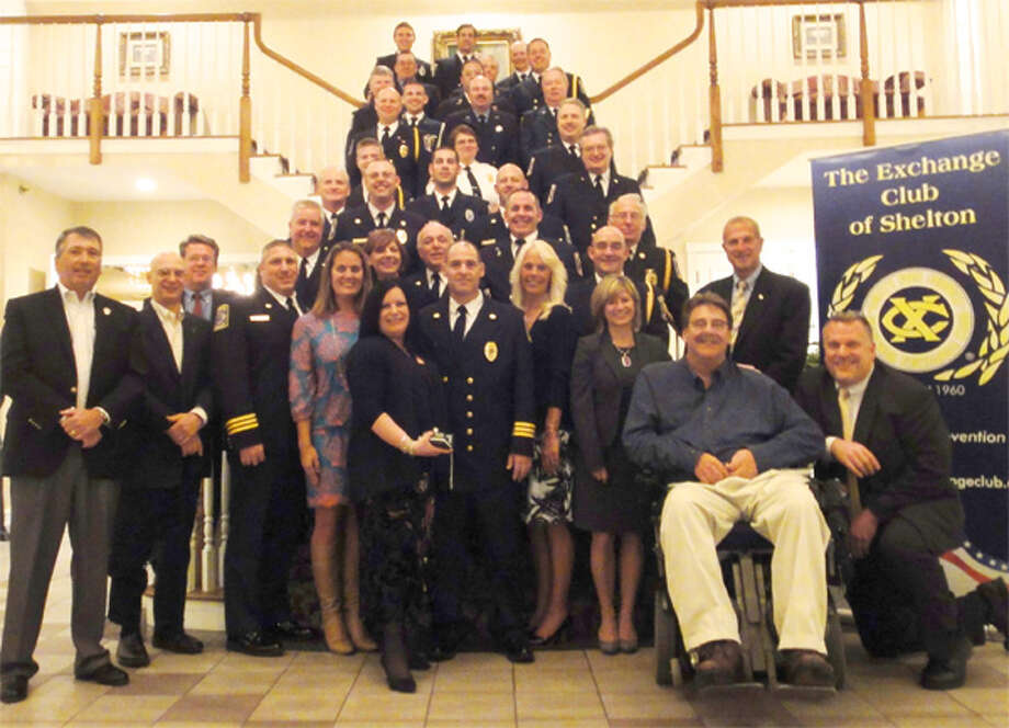 Fellow Shelton firefighters, Shelton Exchange Club members, family, friends and Mayor Mark Lauretti at the Aqua Turf with honoree Edward Tevolitz of the White Hills Volunteer Fire Company.