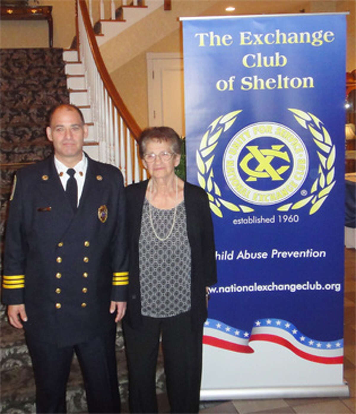 White Hills Assistant Fire Chief Edward Tevolitz with his mother at a state Exchange Club ceremony honoring his service last fall.