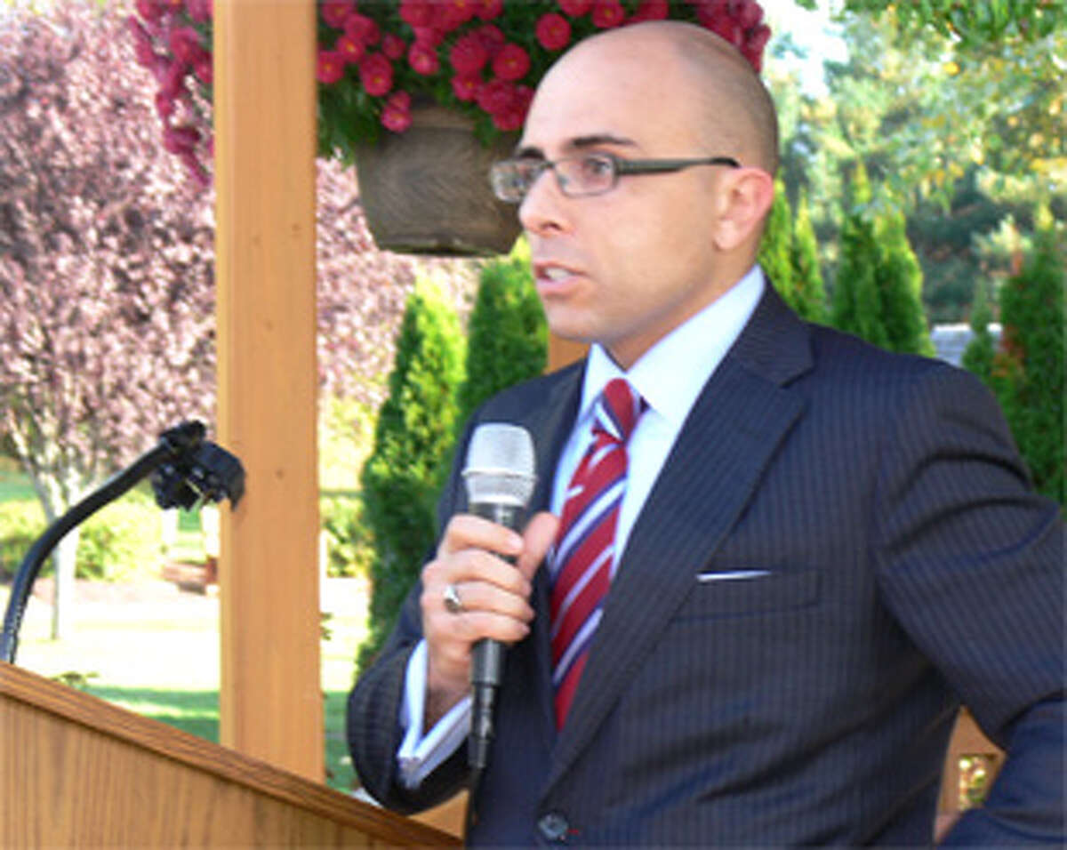 State Rep. Jason Perillo of Shelton speaks at a community event in Shelton.