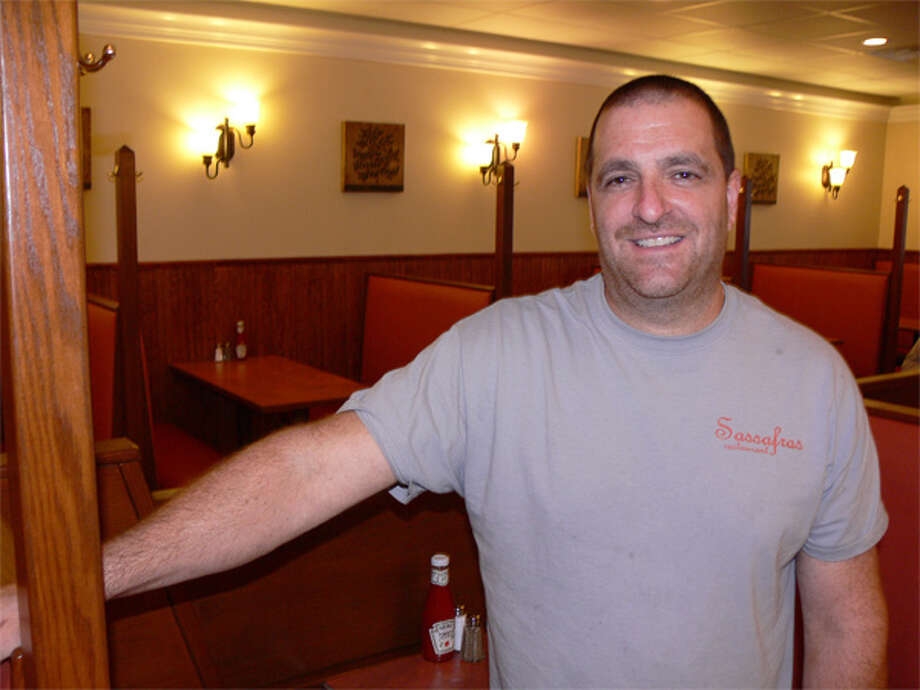 Chef Chris Poniros inside the newly designed Sassafras restaurant in Huntington Center.