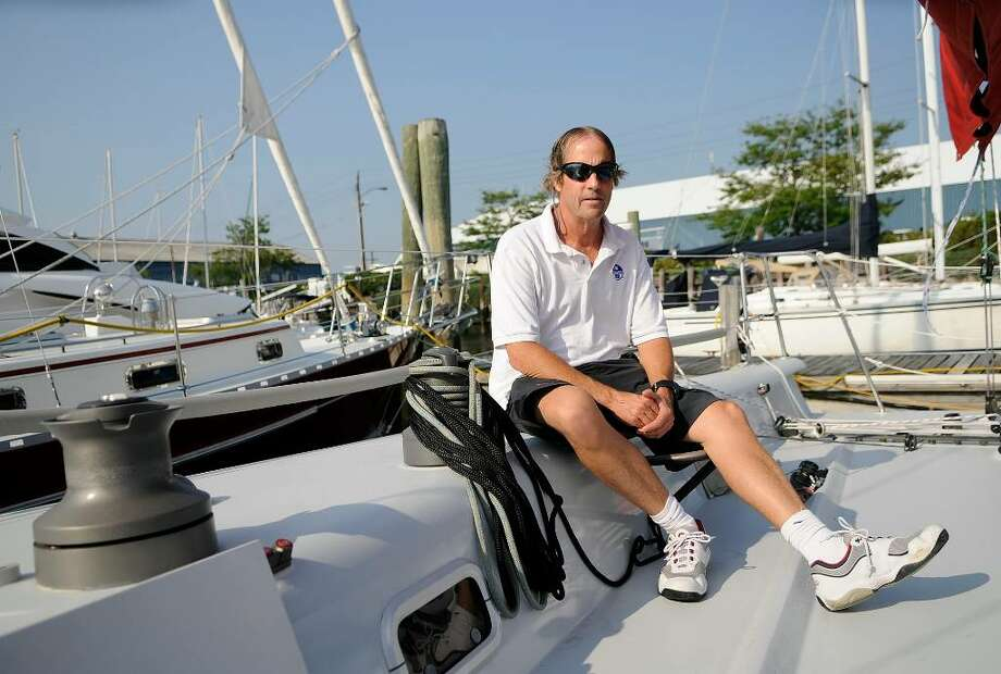 "Olympic medalist Steve Benjamin poses for a portrait on his sailboat called ""After Midnight"" in Stamford on Wednesday, July 28, 2010. Benjamin underwent successful prostate cancer surgery less than six months ago, and plans to participate in the 190-mile Around Long Island Regatta starting Thursday July 29. He plans to sail a different sailboat, the ""Robotic Oncology"" in the regatta. That boat's name is in honor of the life-saving skills of Dr. David B. Samadi, Chief of Robotics and Minimally Invasive Surgery at Mount Sinai in New York, NY. Photo: Shelley Cryan / Shelley Cryan Freelance for the Stamford Advocate"