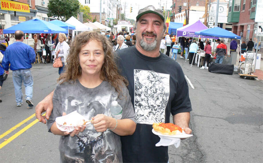 Sheryl and Steve Gabriel enjoy carnival food while standing on Howe Avenue during the Shelton Day celebration.