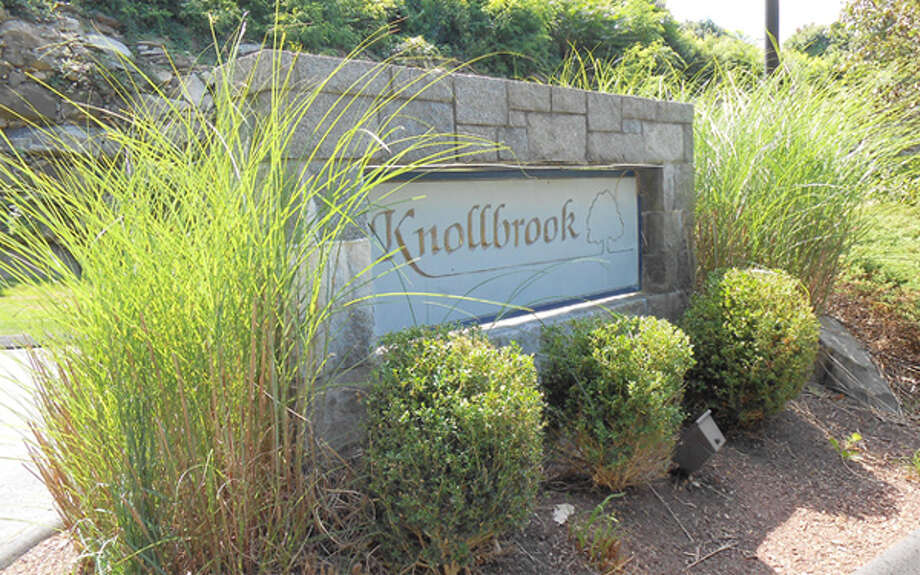 The entrance to Knollbrook Condominiums, a 71-unit complex on Old Bridgeport Road.