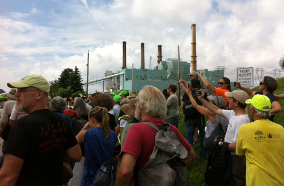 Marchers reach the Brayton Point power plant during a protest demanding the coal-fired facility be closed. (Photo by Susan Hunter)