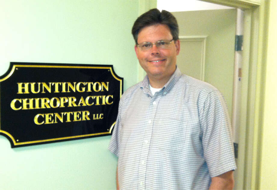 Dr. John H. Litts Jr., a chiropractor with the Huntington Chiropractic Center, at his new office on Trap Falls Road in Shelton.
