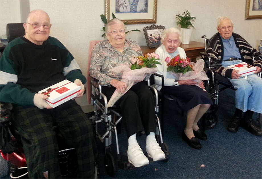 """From left are Crosby Commons centenarians John Tiernan (who will turn 100 this month), Ella Bradbury (105), Anna May Finnucan (who turns 100 in November), and George """"Bush"""" Clark (102)."""