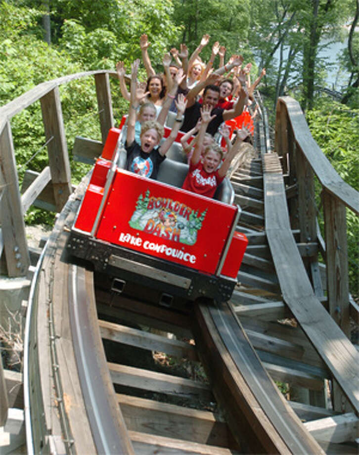 Visitors get a thrill by riding the Boulder Dash roller coaster at Lake Compounce.