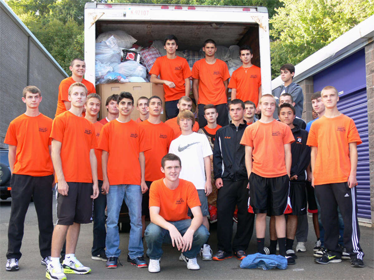 Members of the 2013 Shelton High boys soccer team at last year's used clothing drive.