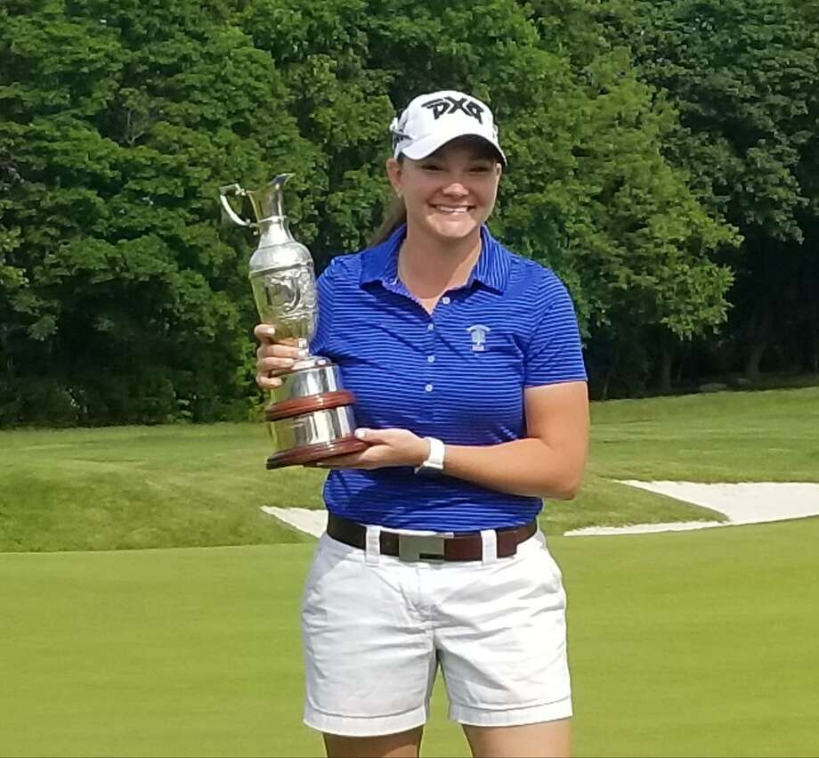 Loretta Gionvannettone poses with the championship golf trophy for winning the 21st Connecticut Women's Open at Brooklawn Country Club in Fairfield on Wednesday. Photo: Joe Morelli / Hearst Connecticut Media