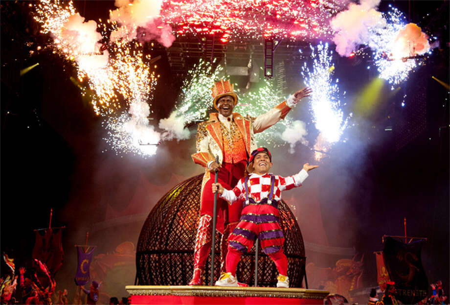 Ringling Bros. and Barnum & Bailey Circus Ringmaster Johnathan Lee Iverson, who is a University of Hartford graduate, with his sidekick Paulo dos Santos during a performance.