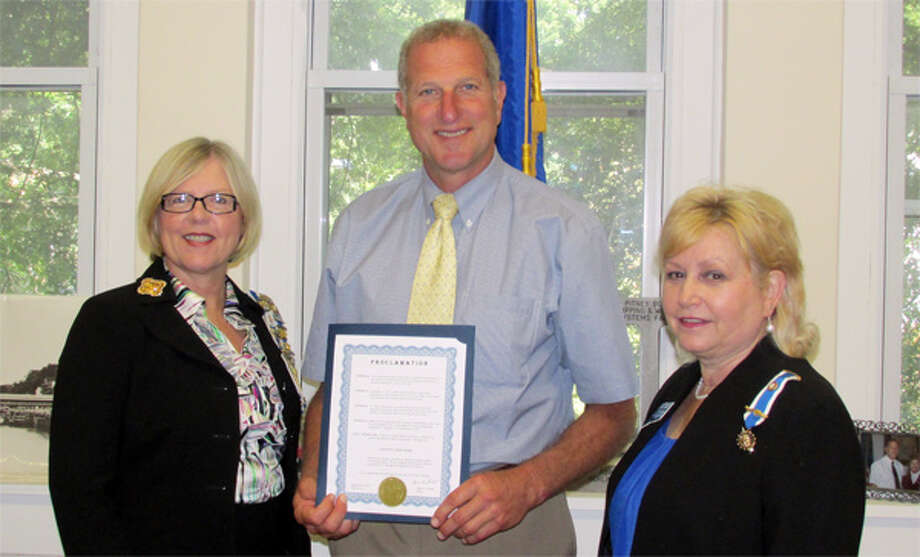 Mayor Mark Lauretti, holding a proclamation declaring Constitution Week from Sept. 17 to 23 in Shelton, with Daughters of the American Revolution local chapter Regent Christy Hendrie, left, and chapter member Linda Papp.