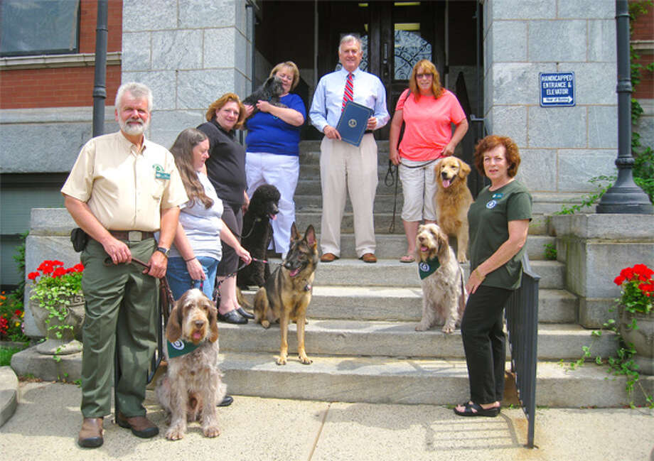 Trap Falls Kennel Club members, with their dogs, on the steps of Ansonia city offices, are Christopher Sweetwood, Eva Skrabl, Sarah Murphy, Susan Carter, Ansonia Mayor James Della Volpe, Karen Batistelli of Shelton, and Lauren Friedman.