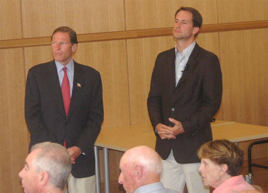 U.S. Sen. Richard Blumenthal, left, and U.S. Rep. Jim Himes listen to constituents discuss whether the United States should take military action against Syria during a Sunday town meeting in Darien.