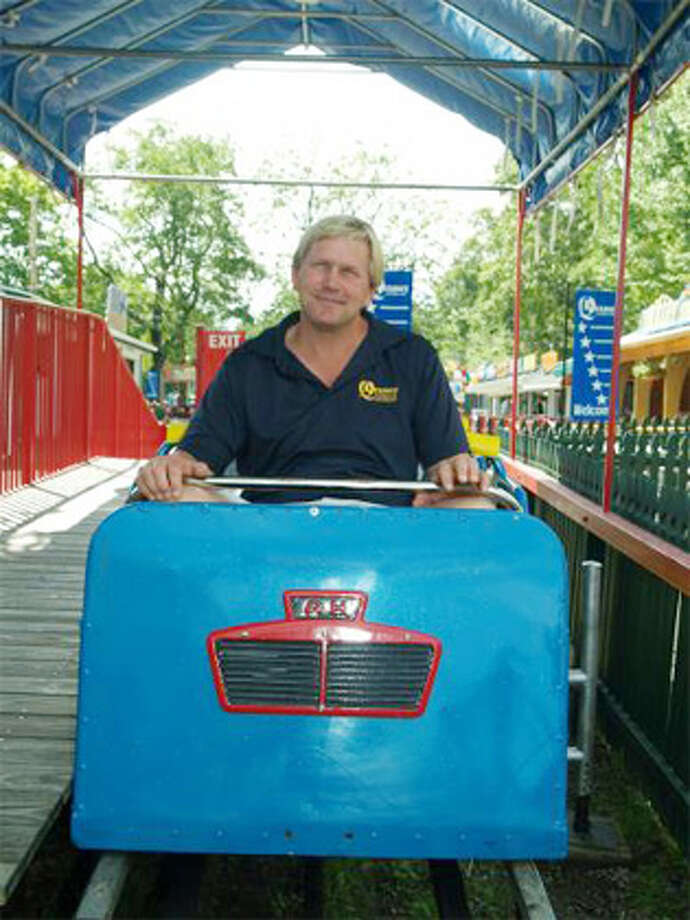 Quassy Amusement Park President Eric Anderson sits in the front seat of the classic Allan Herschell Little Dipper roller coaster at the Middlebury park. (Quassy-provided photo by Ron Gustafson)