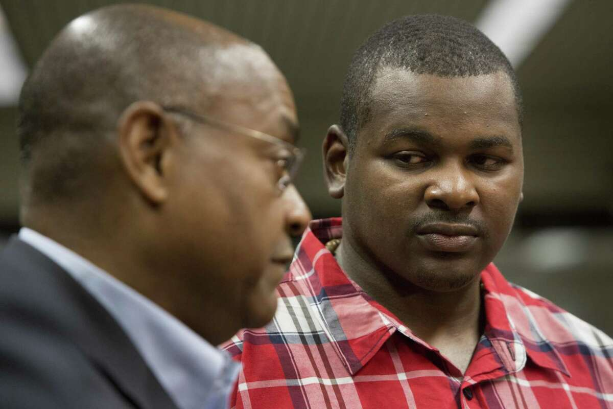 Alfred Dewayne Brown, right, 33, listens to state Sen. Rodney Ellis talk about the request to compensate Brown with state funds for his wrongful conviction. Brown's attorneys are seeking almost $1 million, as well as health-care and tuition dollars for his daughter's education. Brown was convicted of capital murder and sentenced to death in October 2005. After 12 years imprisoned, his conviction was overturned after the discovery of evidence substantiating his alibi. Monday, Feb. 22, 2016, in Houston.
