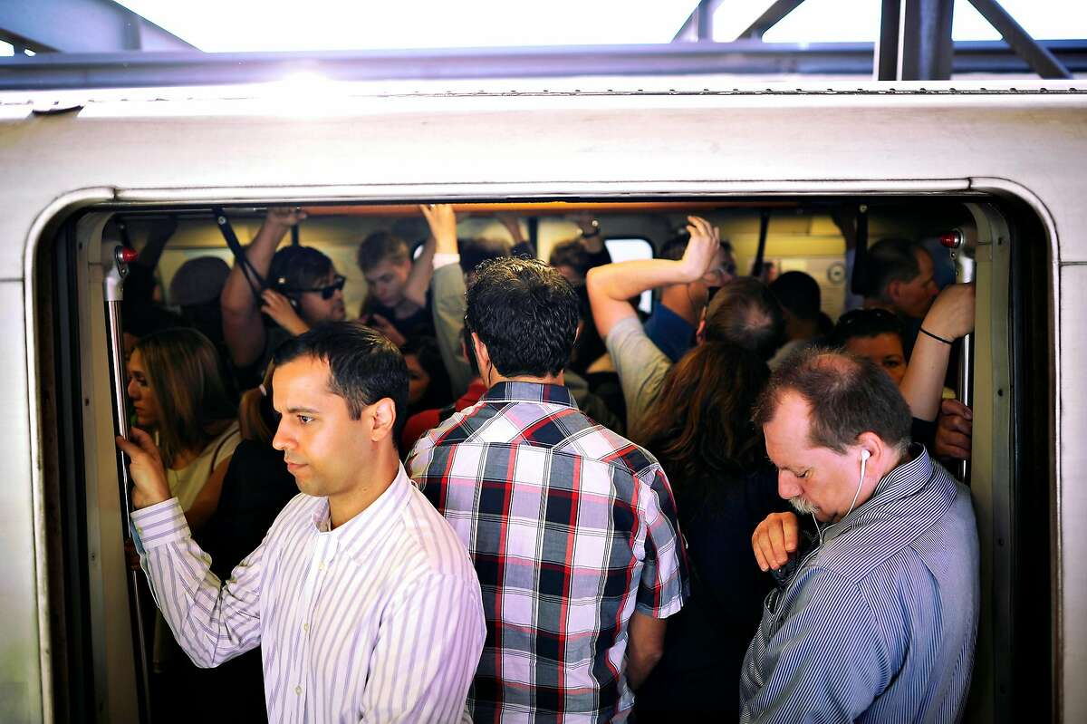 Crowds of commuters are seen tightly packed aboard a San Francisco bound train as it wait to leave the MacArthur BART station in Oakland, CA on Friday May 31st, 2013. BART is experiencing severe delays while trains are running single track after two maintenance vehicles collided in the transbay tube, resulting in track damage needing repair.