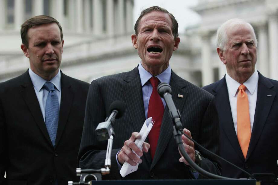 "WASHINGTON, DC - JUNE 05: U.S. Sen. Richard Blumenthal (D-CT) (C) speaks as (L-R) Sen. Chris Murphy (D-CT) and Rep. Mike Thompson (D-CA) listen during a news conference June 5, 2019 on Capitol Hill in Washington, DC. Democratic lawmakers held a news conference to mark June as Gun Violence Prevention Month and to mark 100 days since House passage of H.R.8, the ""Bipartisan Background Checks Act of 2019"" to expand background checks to cover all gun sales and most transfers, and to call on Senate Majority Leader McConnell to hold a vote on the bill. (Photo by Alex Wong/Getty Images) Photo: Alex Wong / Getty Images / 2019 Getty Images"