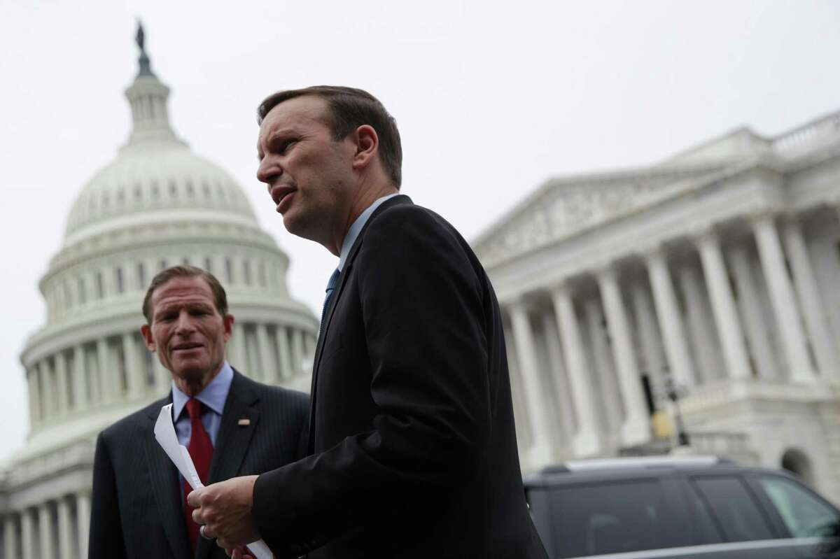 """WASHINGTON, DC - JUNE 05: U.S. Sen. Chris Murphy (D-CT) (R) talks to Sen. Richard Blumenthal (D-CT) (L) prior to a news conference June 5, 2019 on Capitol Hill in Washington, DC. Democratic lawmakers held a news conference to mark June as Gun Violence Prevention Month and to mark 100 days since House passage of H.R.8, the """"Bipartisan Background Checks Act of 2019"""" to expand background checks to cover all gun sales and most transfers, and to call on Senate Majority Leader McConnell to hold a vote on the bill. (Photo by Alex Wong/Getty Images)"""