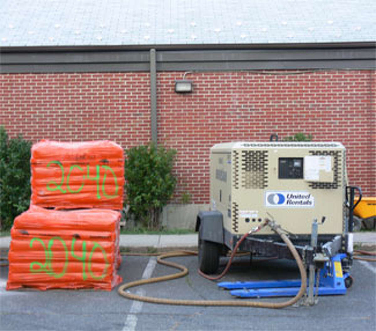 Equipment being used during renovation work at the Shelton Community Center swimming pool.