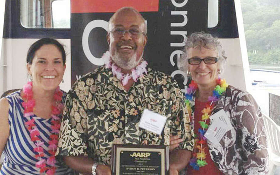 Shelton resident Byron Peterson, center, was honored as the AARP Connecticut 2013 Volunteer Specialist of the Year during an AARP volunteer recognition luncheon. Standing with him are AARP State Director Nora Duncan, left, and AARP Connecticut State President Laura Green.