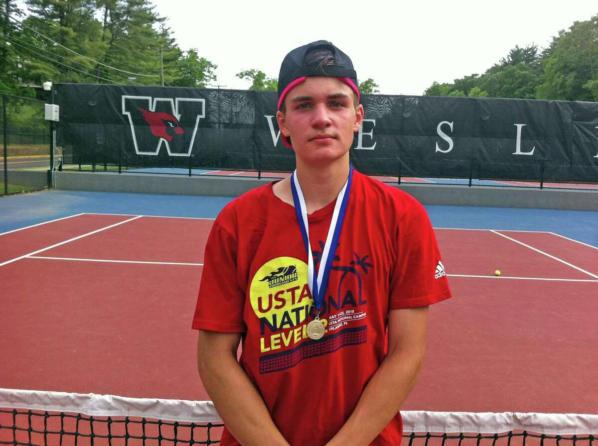 Trumbull High School junior Andrew Ilie won the CIAC State Open boys singles title with a 6-2, 6-3 win over Michael Karr of Darien in the championship match on at Wesleyan University in Middletown on Wednesday, June 5, 2019.