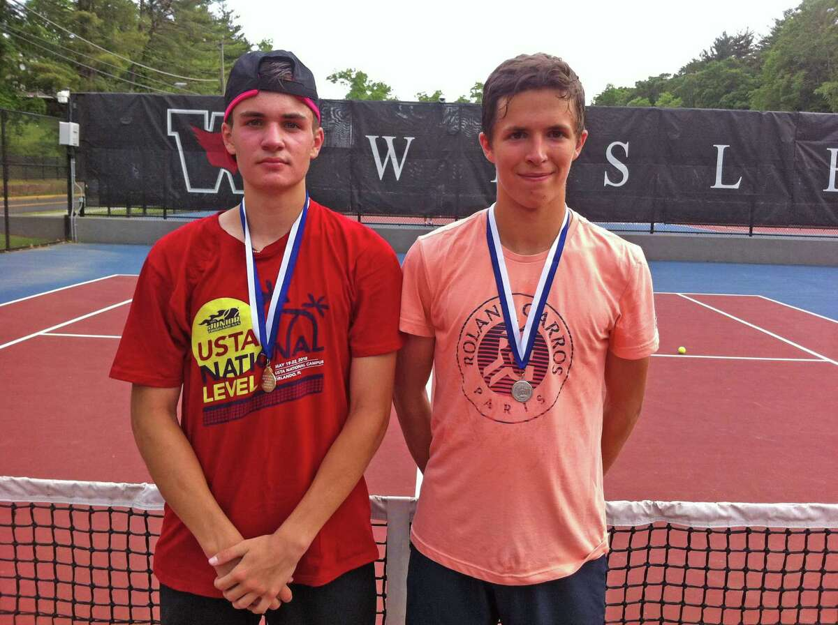 Trumbull High School junior Andrew Ilie, left, won the CIAC State Open boys singles title with a 6-2, 6-3 win over Michael Karr (right) of Darien in the championship match on at Wesleyan University in Middletown on Wednesday, June 5, 2019.
