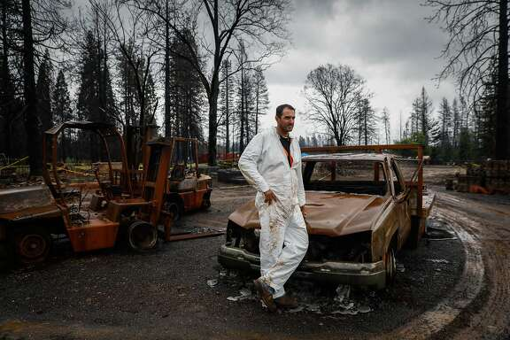 Luke Bellefeuille stands for a portrait while cleaning up a family friend's property that was destroyed during the Camp Fire in Paradise, California, on Wednesday, May 15, 2019. Luke works for PG&E and lost his house in the Camp Fire. He decided to take a leave of absence to help family and friends with property damage.