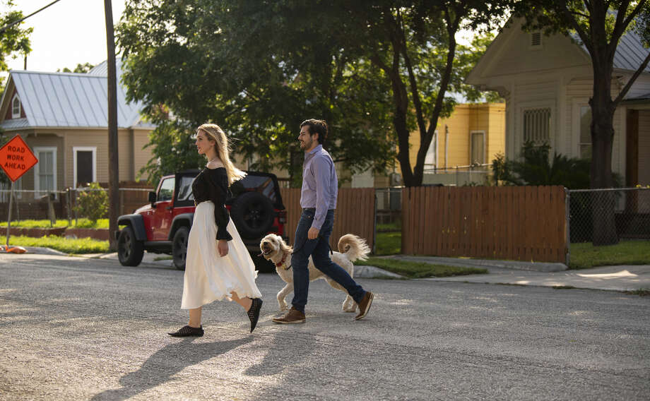 Rodolfo de Leon and Juliana Day Huff take their dog, Godfrey, for a walk along West Euclid Avenue in San Antonio. Photo: Carlos Javier Sanchez