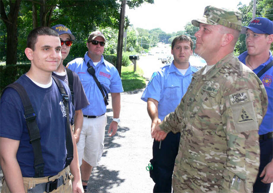 Shelton firefighters greet former Echo Hose firefighter Pete Nichio, who just spent 10 months serving in Afghanistan with the National Guard.
