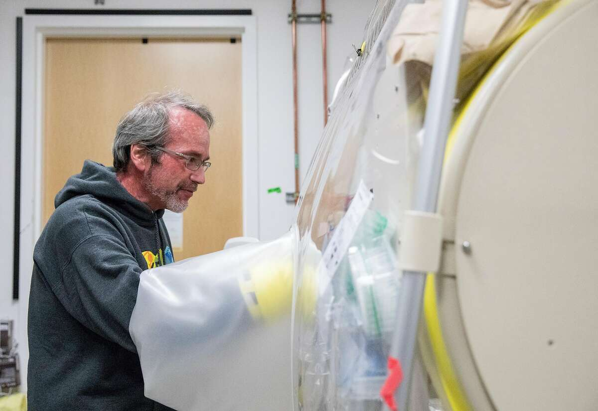UC Berkeley Bioengineering Professor Adam Arkin demonstrates work being done to find ways to find which plants and other living organisms could be grown on future missions to the moon and Mars inside the NASA Center for Utilization of Biological Engineering in Space lab inside UC Berkeley's Science Institute in Berkeley, Calif. Tuesday, June 4, 2019.