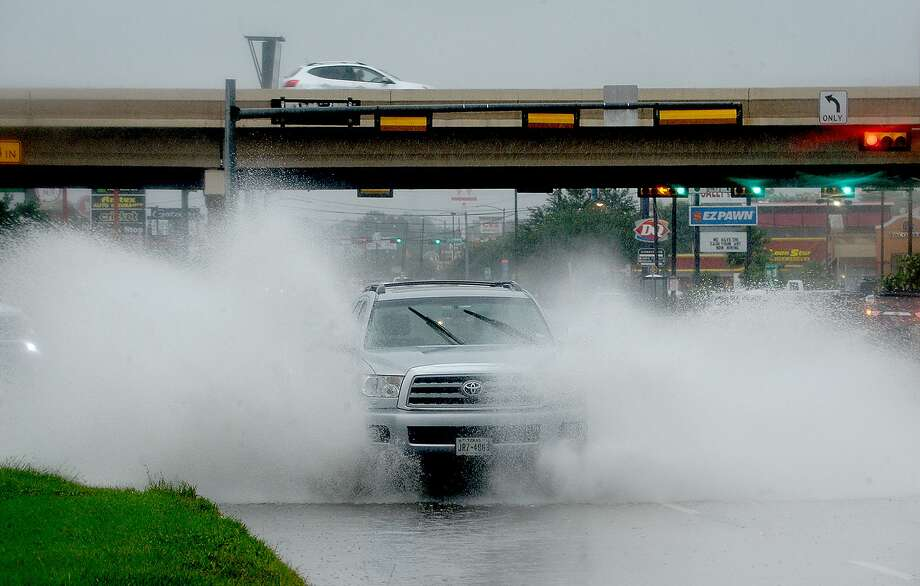 A truck makes its way through a flooded curb lane on College Street near Interstate 10 as heavy rain continues to fall throughout the region Wednesday.  Photo taken Wednesday, June 5, 2019 Kim Brent/The Enterprise Photo: Kim Brent / The Enterprise / BEN