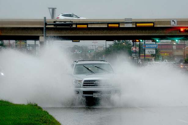 A truck makes its way through a flooded curb lane on College Street near Interstate 10 as heavy rain continues to fall throughout the region Wednesday. Photo taken Wednesday, June 5, 2019 Kim Brent/The Enterprise