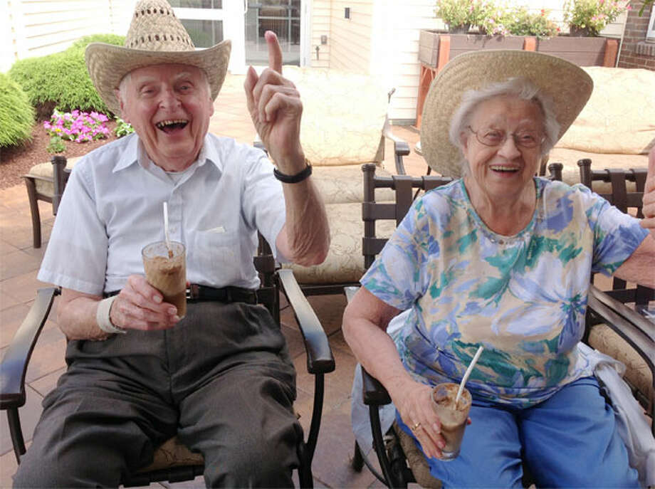 Crosby Commons residents Hank Gambaccini and Corrine Sharp drink sarsaparilla floats for Country Western Day.