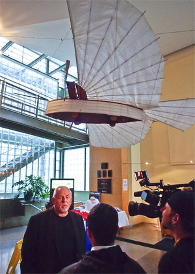 Actor and Bridgeport native John Ratzenberger talks with others at a Discovery Museum of Bridgeport event that highlighted the contributions of Gustave Whitehead, with a replica of Whitehead's aircraft hanging from the ceiling. (Photo by Wayne Ratzenberger)