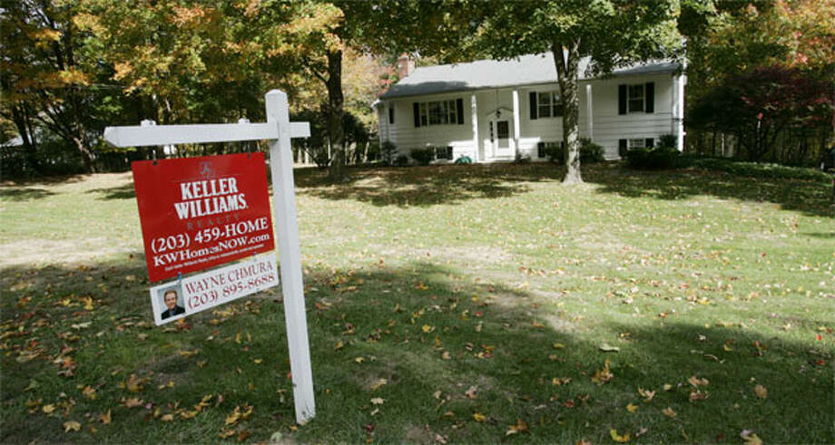A house with a For Sale sign in the region. (File photo)
