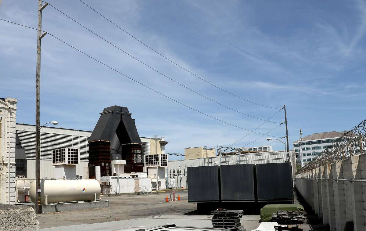 Part of the old fossil fuel power plant (at left) is seen at 50 Martin Luther King Jr. Way on Wednesday, June 5, 2019 in Oakland, Calif.