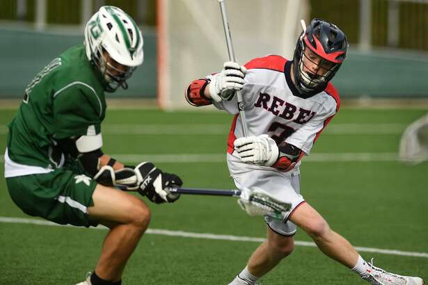 Guilford's Jackson Tandler, left, and New Fairfield's Dylan Hanley pursue a loose ball during the Rebels' victory in the Class M state semifinals at Fairfield University on Wednesday.