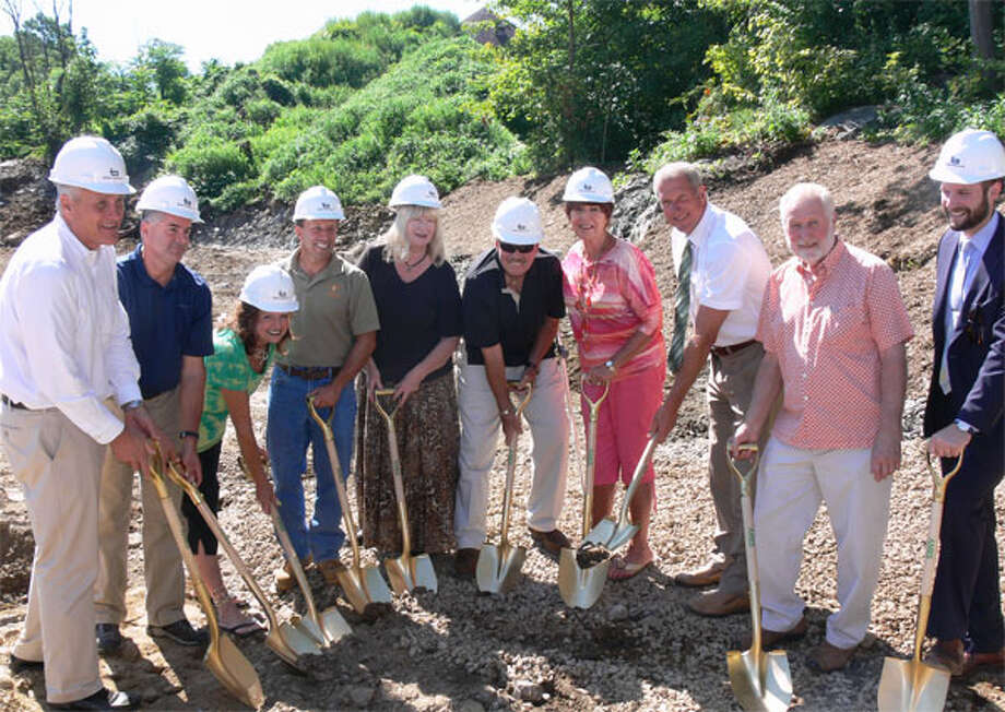 Animal Shelter Building Committee members pose with city officials and those involved in the design and construction during the ground-breaking ceremony.