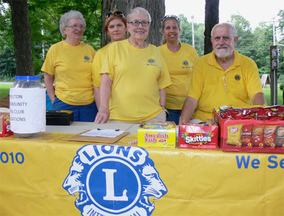 Staffing the Shelton Community Lions Club table at a Huntington Green concert are, from left, Barbara Osterhoudt, Rebecca Twombly, Natalie Skinner, Laura Blakeman (secretary), and David Haddad (president).