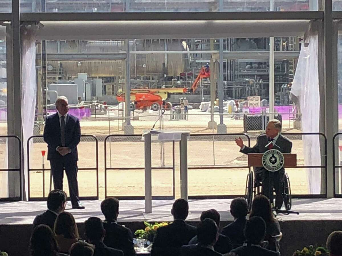 Texas Gov. Greg Abbott speaks while Cheniere Energy CEO Jack Fusco listens during a Thursday, November 15, 2018 event to commemorate the grand opening of Corpus Christi LNG. Located at the Port of Corpus Christi, the facility became the first in Texas to export a shipment of liquefied natural gas.