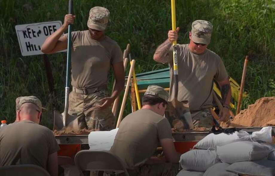 National Guardsmen fill sandbags in Grafton on Tuesday. Photo: Nathan Woodside | The Telegraph