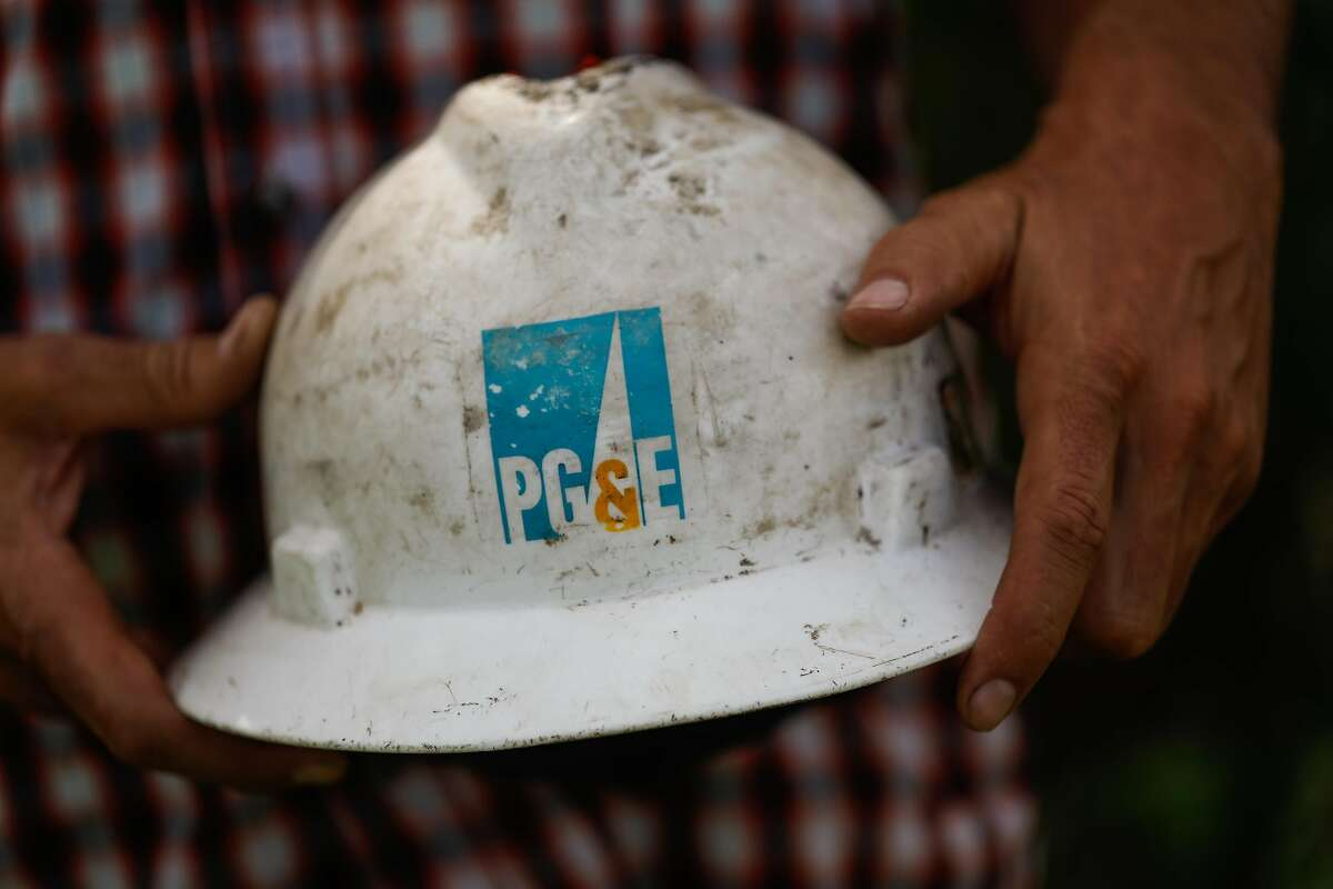 Luke Bellefeuille holds his PG&E hard hat in Paradise, California, on Thursday, May 23, 2019. Luke works for PG&E and lost his house in the Camp Fire. He decided to take a leave of absence to help family and friends with property damage.