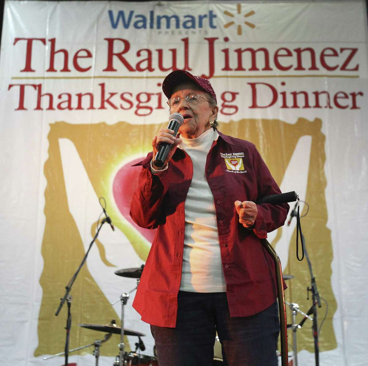 Mary Jimenez, wife of Raul Jimenez, addresses an audience at the 35th Annual Raul Jimenez Thanksgiving Dinner at the Convention Center on Thursday, Nov. 27, 2014. Each year about 25,000 guests gather for a Thanksgiving meal hosted by Patricia Jimenez who has overseen the event since the passing of her father who started the charitable event 35 years ago. About 9,400 pounds of turkey, 6,250 pounds of stuffing and green beans, 4,688 pounds of cranberry sauce and yams, 32, 000 rolls, 650 pounds of gravy and 3,000 pumpkin pies were served. The warm meal fills the heart and stomaches of many in San Antonio who may not have the ability to make do. Over 4,000 volunteers come out every year to help at the event. The remainder of the food will be donated to Daily Bread Ministries according to officials. (Kin Man Hui/San Antonio Express-News)