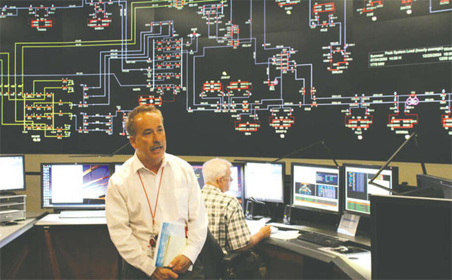 A large screen in United Illuminating's Orange headquarters, showing a simulated image during a media tour, allows the company to monitor the flow of electricity to Shelton and the 16 other towns it serves. (Photo by John Kovach)