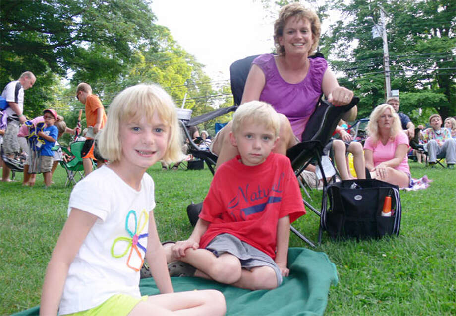 Watching the show are members of Sullivan family of Shelton — from left, Abigal, 6; her twin brother Logan, 6; and mom Kim. (Photos by Brad Durrell)