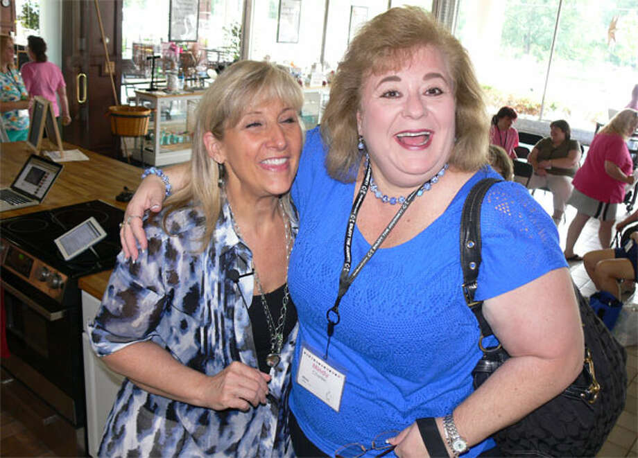 Weight-loss instructor Kim Bensen, left, with client Mindy Cherkin of Allen, Texas at the reunion event in Shelton.