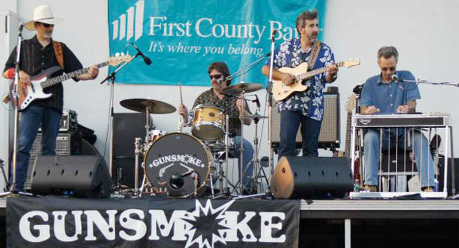 The country music band Gunsmoke performs at a show. (Photo from the band's website)