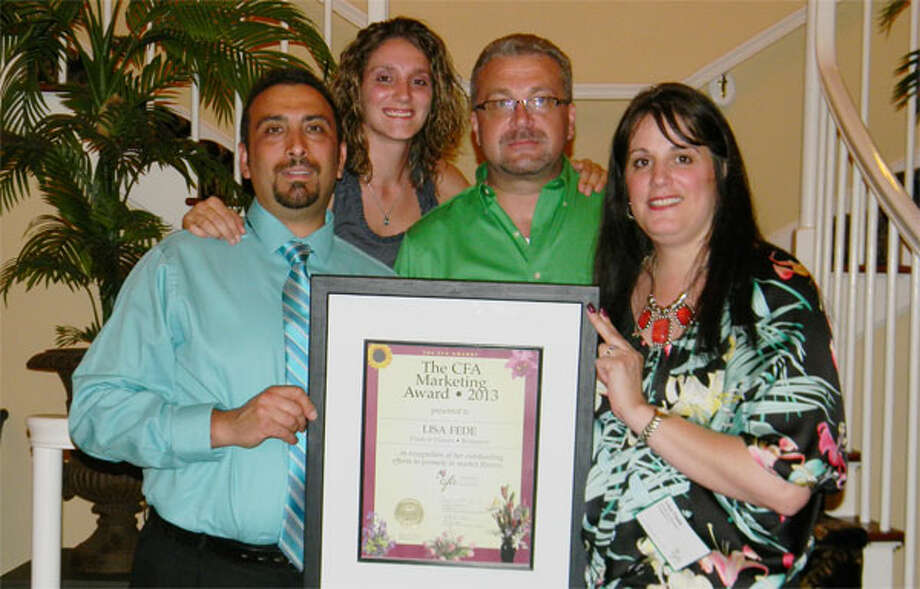 Holding the Connecticut Florists Association award from the Fruits & Flowers shop are, from left, Nello Fede, Jessica Minotti, Lee Reiske and Shelton resident Lisa Fede. Fruits & Flowers is at 566 Lindley St. in Bridgeport's North End.