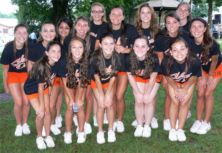 The Shelton High School Pom Pons pose at this week's concert on the Huntington Green.